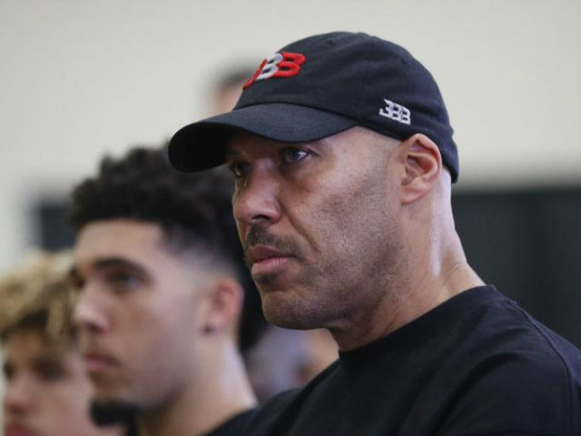 LaVar Ball, center, father of Los Angeles Lakers draft pick Lonzo Ball, listens to his son during a news conference, Friday, June 23, 2017, in El Segundo, Calif. (AP Photo/Jae C. Hong)