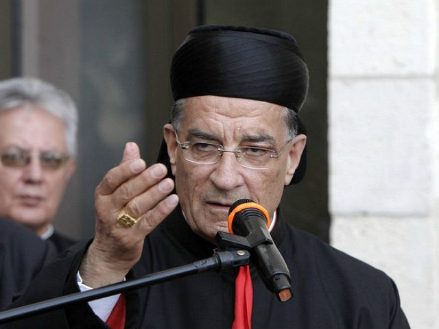 Lebanese Maronite patriarch Beshara Rai (C) speaks at a reception in Notre Dame Center in Jerusalem's Old City on May 27, 2014. A decision by Lebanon's Maronite patriarch to make an unprecedented trip to Jerusalem with the pope this month has drawn criticism from the Hezbollah movement and media close …