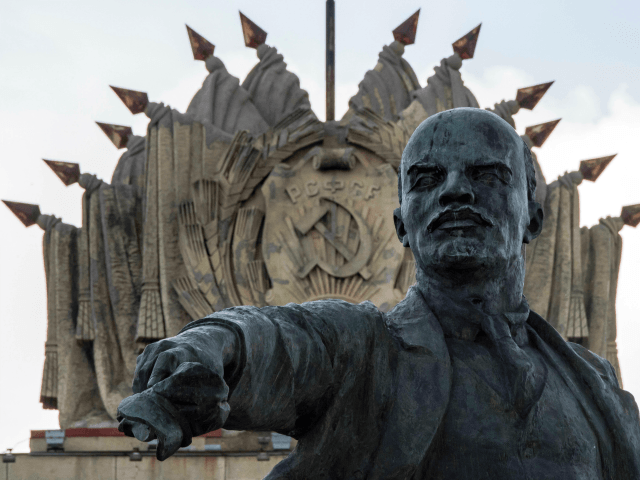 A photo taken on June 25, 2017 shows a sculpture of the founder of the Soviet Union Vladimir Lenin erected in 1970 at Moscow Square in front of the House of Soviets in Saint Petersburg. This year Russia will mark the 100 Anniversary of the Bolshevik Revolution also known as the October Revolution in which Vladimir Lenin's Bolshevik Communist government came to power. communism