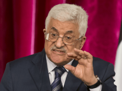 In this Sept. 19, 2014 file photo, Palestinian President Mahmoud Abbas gestures as he speaks during a media conference at the Elysee Palace in Paris. The Hamas militant group on Sunday, Sept. 7, 2017, said it has accepted key conditions demanded by its rival, President Mahmoud Abbas, including nationwide elections …
