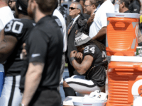 Oakland Raiders running back Marshawn Lynch (24) sits during the national anthem before an NFL football game between the Raiders and the Tennessee Titans Sunday, Sept. 10, 2017, in Nashville, Tenn. (AP Photo/Mark Zaleski)