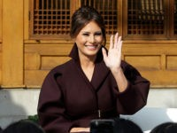 "U.S. first lady Melania Trump and Choi Min-ho, a member of South Korean boy band Shinee, wave to South Korean middles school students during ""Girls Play 2!"" Initiative, an Olympic public diplomacy outreach campaign, at the U.S. Ambassador's Residence in Seoul, South Korea, Tuesday, Nov. 7, 2017. (AP Photo/Ahn Young-joon. …"