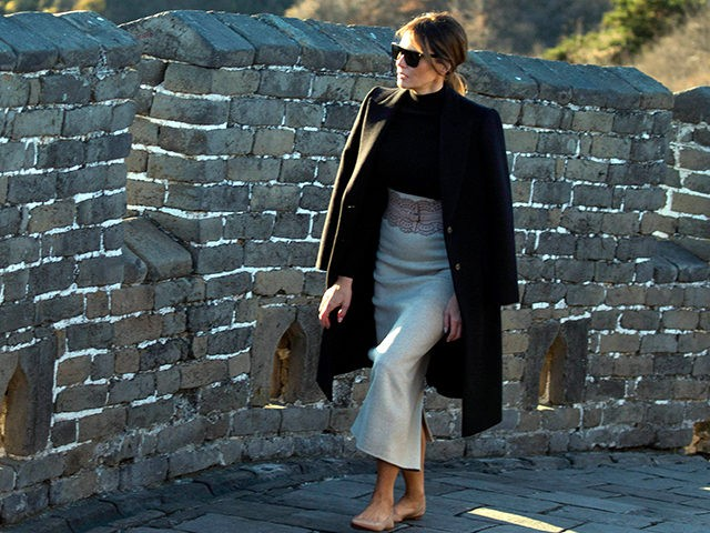 U.S. first lady Melania Trump walks along the Mutianyu Great Wall section in Beijing Friday, Nov. 10, 2017. Mrs. Trump toured China's famed Great Wall at Mutianyu, where she rode a cable car to a watchtower, signed a guestbook and strolled along a stretch of the wall for about half …