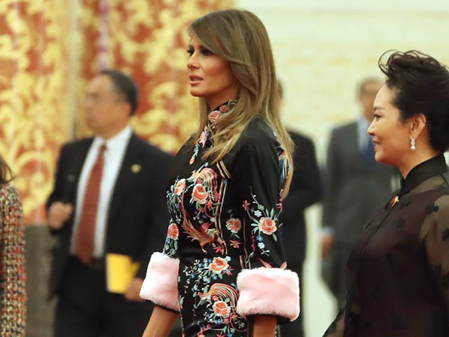 U.S. President Donald Trump, accompanied by U.S. first lady Melania Trump, second from right, and Chinese first lady Peng Liyuan, right, arrives for a state dinner at the Great Hall of the People, Thursday, Nov. 9, 2017, in Beijing. Trump is on a five-country trip through Asia traveling to Japan, South Korea, China, Vietnam and the Philippines. (AP Photo/Andrew Harnik)