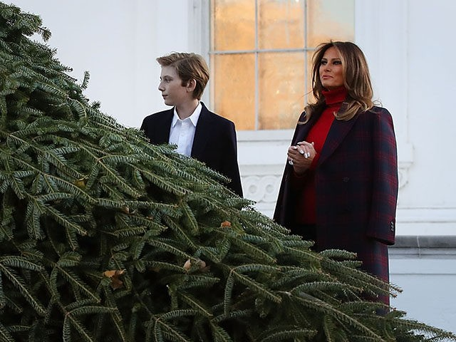 WASHINGTON, DC - NOVEMBER 20: First lady Melania Trump and her son Barron inspect the 19.5-foot balsam Fir that will serve as the official White House Christmas Tree at the White House on November 20, 2017. The tree is a Wisconsin grown Fir provided by the Chapman family of Silent …