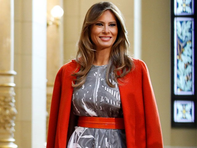Photos: Melania Trump is Making 'Coat-Slinging' Fashionable Again