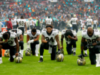 LONDON, ENGLAND - OCTOBER 01: New Orleans Saints players and team kneel prior to the NFL match between New Orleans Saints and Miami Dolphins at Wembley Stadium on October 1, 2017 in London, England. (Photo by Clive Rose/Getty Images)
