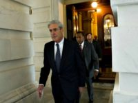 Mueller Walking Saul LoebAFPGetty Images