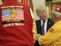 U.S. President Donald Trump (R) greets members of the Native American code talkers during an event in the Oval Office of the White House, on November 27, 2017 in Washington, DC. Trump stated, 'You were here long before any of us were here. Although we have a representative in Congress who they say was here a long time ago. They call her Pocahontas.' in reference to his nickname for Sen. Elizabeth Warren. (Photo by Oliver Contreras-Pool/Getty Images)