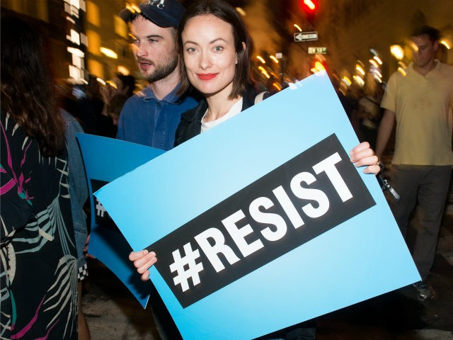 Olivia Wilde joins Michael Moore as he leads his Broadway audience to Trump Tower to protest President Donald Trump on August 15, 2017 in New York City. (Photo by Noam Galai/Getty Images for for DKC/O&M)