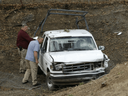 "Investigators view a pickup truck involved in a deadly shooting at the Rancho Tehama Reserve, near Corning, Calif., Tuesday, Nov. 14, 2017. A gunman driving stolen vehicles and choosing his targets at random opened fire ""without provocation"" in the tiny, rural Northern California town Tuesday, killing several people, including a …"