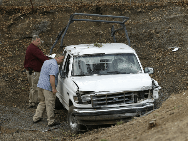 "Investigators view a pickup truck involved in a deadly shooting at the Rancho Tehama Reserve, near Corning, Calif., Tuesday, Nov. 14, 2017. A gunman driving stolen vehicles and choosing his targets at random opened fire ""without provocation"" in the tiny, rural Northern California town Tuesday, killing several people, including a student at an elementary school, before police shot him dead, authorities said. (AP Photo/Rich Pedroncelli)"