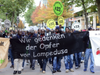 Refugees from Africa and supporters hold a banner reading 'We remember the vicitms of Lampedusa' as they participate in a demonstration on October 23, 2013 in Hamburg, Germany