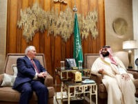 Secretary of State Rex Tillerson and Saudi Crown Prince Mohammed bin Salman are seated for their meeting at Al-Awja Farm, Sunday, Oct. 22, 2017, in Riyadh, Saudi Arabia. (AP Photo/Alex Brandon, Pool)