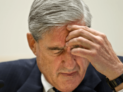 FBI Director Robert Mueller testifies on Capitol Hill in Washington, Wednesday, May 9, 2012, before the House Judiciary Committee. (AP Photo/J. Scott Applewhite)