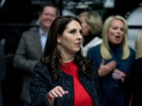 Michigan Republican Party Chairman Ronna Romney McDaniel arrives before President-elect Donald Trump takes the stage at a rally at DeltaPlex Arena, Friday, Dec. 9, 2016, in Grand Rapids, Mich. (AP Photo/Andrew Harnik)