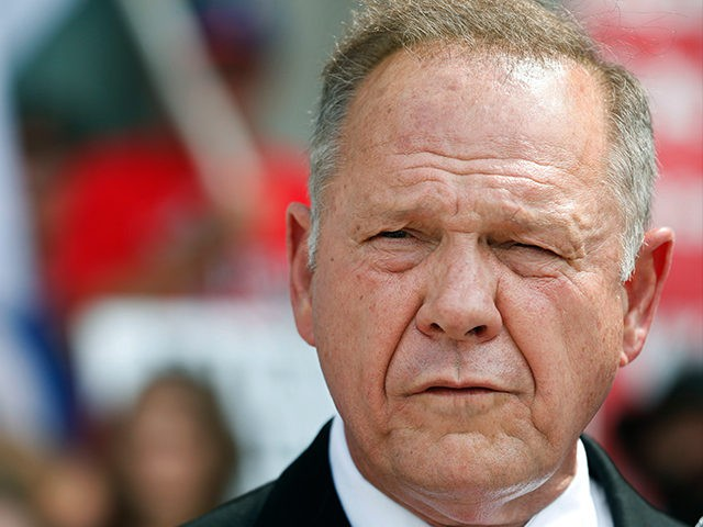 FILE - In this Aug. 8, 2016 file photo, Alabama Chief Justice Roy Moore speaks to the media during a news conference in Montgomery, Ala. Moore appeared before a judicial discipline panel Wednesday, Sept. 28, 2016, to answer accusations that he tried to block gay couples from marrying in the …