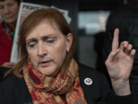 Britain's opposition Labour Party MP for Kensinton, Emma Dent Coad, gestures as she leaves after attending the opening statements for the Inquiry into the Grenfell Tower fire disaster, in London on September 14, 2017. An inquiry into the June 14, 2017 Grenfell Tower fire disaster opened on Thursday with a …