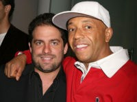NEW YORK - MAY 11: Brett Ratner (L) and Russell Simmons (R) attend the premiere photography exhibit of portraits by Brett Ratner, presented by Russell Simmons and Gary Barnett, held at Altair Lofts May 11, 2006 in New York. (Photo by Amy Sussman/Getty Images)