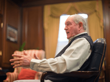 "Outgoing Georgia Gov. Sonny Perdue is photographed during an interview in his office Wednesday, Dec. 22, 2010, in Atlanta. Perdue said Wednesday that fellow Republicans need to choose their words carefully when it comes to the emotionally charged debates over immigration. Perdue said his party needs to avoid ""a gang-type …"