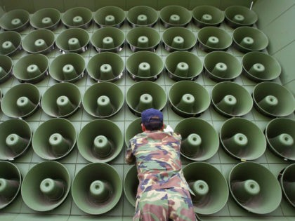 A South Korean soldier takes down a battery of propaganda loudspeakers on the border with North Korea in Paju on 16 June 2004 in Paju, South Korea. The removal of the propaganda devices along the world?s last Cold War frontier follows on from the inter-Korean summit accord which was reached …