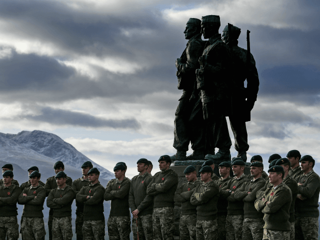 SPEAN BRIDGE, UNITED KINGDOM - NOVEMBER 11: Serving servicemen and veterans gather at Commando Memorial, Spean Bridge where they observed a two minute silence as a mark of respect for the war dead on November 11, 2017 in Spean Bridge, Scotland. Armistice Day traditionally marks the end of the WWI …