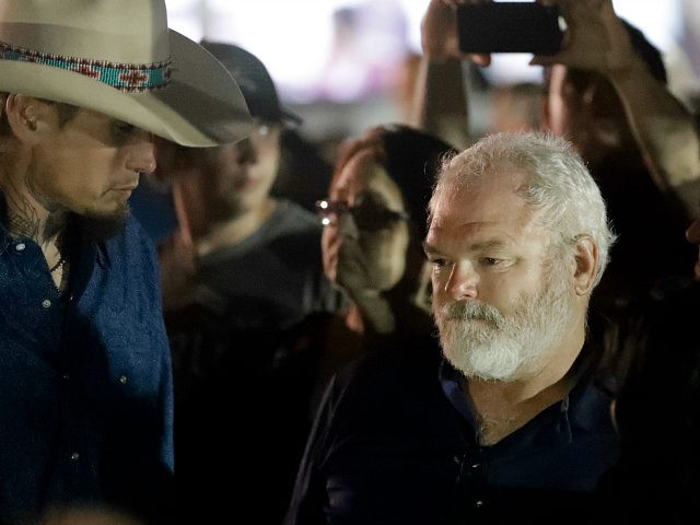 Stephen Willeford, right and Johnnie Langendorff, left, attend a vigil for the victims of the First Baptist Church shooting Monday, Nov. 6, 2017, in Sutherland Springs, Texas. Willeford shot suspect Devin Patrick Kelley, and Langendorff drove the truck while chasing Kelley. Kelley had opened fire inside the church in the small South Texas community on Sunday, killing more than two dozen and injuring others. (AP Photo/David J. Phillip)