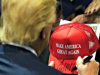 Trump Holds MAGA Hat