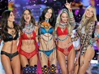 Models Romee Strijd, from right, Candice Swanepoel, Adriana Lima, Alessandra Ambrosio, Lily Aldridge, Elsa Hosk, wear creations with other models during the Victoria's Secret fashion show at the Mercedes-Benz Arena in Shanghai, China, Monday, Nov. 20, 2017. (AP Photo/Andy Wong)