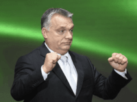 Prime Minister of Hungary Viktor Orban gestures after delivering his speech during an official celebration of the national holiday marking the 61st anniversary of the outbreak of the Hungarian revolution and war of independence against communist rule and the Soviet Union in 1956 in front of the House of Terror …