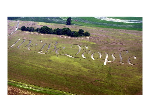 """""""We the People,"""" the beginning of the preamble of the U.S. Constitution, is seen cut into a wheat field on the farm of Jack Coleman in Ronks, Pa., Thursday, June 26, 2003. (AP Photo/Chris Gardner)"""