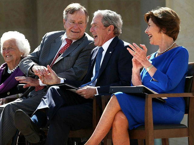 DALLAS, TX - APRIL 25: Former U.S. President George W. Bush (3rd L) shaks hands with his father former President George H.W. Bush (2nd L) as they attend the opening ceremony of the George W. Bush Presidential Center with his wife, former first lady Laura Bush (R), and his mother, …