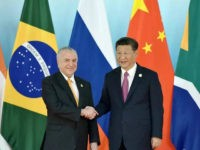 XIAMEN, CHINA - SEPTEMBER 04: Chinese President Xi Jinping (R) shakes hands with Brazil's President Michel Temer before the group photo during the BRICS Summit at Xiamen International Conference and Exhibition Centre on September 4, 2017 in Xiamen, China. The 9th BRICS summit is held from Sep 3 to 5 in Xiamen. (Photo by Mao Jianjun/CHINA NEWS SERVICE/VCG via Getty Images)