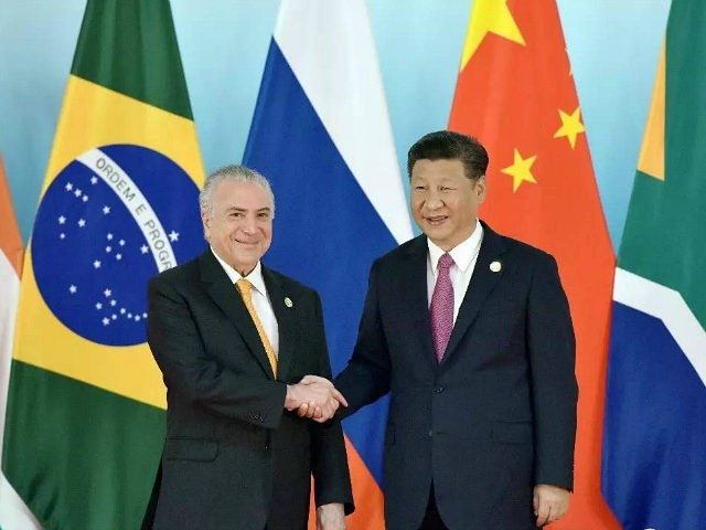 XIAMEN, CHINA - SEPTEMBER 04: Chinese President Xi Jinping (R) shakes hands with Brazil's President Michel Temer before the group photo during the BRICS Summit at Xiamen International Conference and Exhibition Centre on September 4, 2017 in Xiamen, China. The 9th BRICS summit is held from Sep 3 to 5 …
