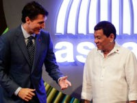 Canadian Prime Minister Justin Trudeau (L) talks to Philippine President Rodrigo Duterte (R) before the opening ceremony of the 31st Association of Southeast Asian Nations (ASEAN) Summit in Manila on November 13, 2017. World leaders are in the Philippines' capital for two days of summits. / AFP PHOTO / AFP …
