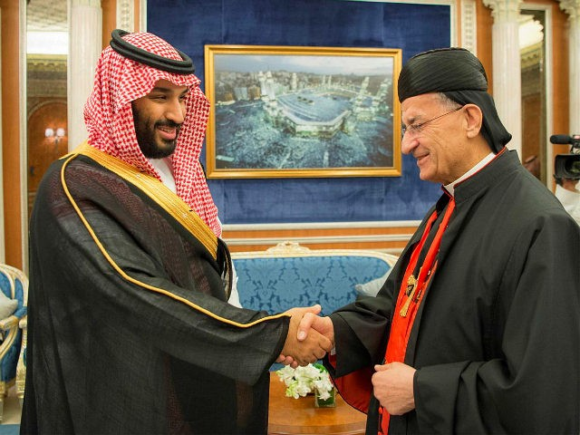 RIYADH, SAUDI ARABIA - NOVEMBER 14: (----EDITORIAL USE ONLY MANDATORY CREDIT - 'BANDAR ALGALOUD / SAUDI ROYAL COUNCIL / HANDOUT' - NO MARKETING NO ADVERTISING CAMPAIGNS - DISTRIBUTED AS A SERVICE TO CLIENTS----) Crown Prince and Defense Minister of Saudi Arabia Mohammad bin Salman (L) shakes hands with Maronite Patriarch …
