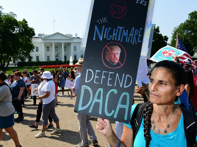 WASHINGTON, DC - SEPTEMBER 05: Jill Weiler holds a sign in support of DACA as she and others prepare to march from the White House on Tuesday September 05, 2017 in Washington, DC. (Photo by Matt McClain/The Washington Post via Getty Images)