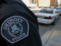 The emblem for the Detroit Police Department is seen on the sleeve of an officer outside of the Theodore Levin U.S. Courthouse in Detroit, Michigan, U.S., on Wednesday, July 24, 2013. Detroit began its first court hearing after filing the biggest U.S. municipal bankruptcy. The city plans to seek a …