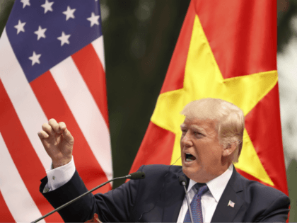 In this Nov. 12, 2017 file photo, President Donald Trump speaks during a news conference at the Presidential Palace, in Hanoi, Vietnam. President Trump is offering to mediate in the South China Sea disputes, while his Chinese counterpart Xi Jinping is playing down China's military buildup in the disputed waters. …