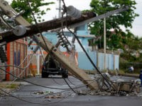 Power line poles downed by the passing of Hurricane Maria lie on a street in San Juan, Puerto Rico on November 7, 2017. The Center for Puerto Rican Studies at Hunter College in New York estimated in a report released last month that about 114,000 to 213,000 Puerto Rican residents …