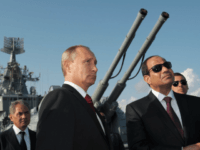 FILE In this file photo taken on Tuesday, Aug. 12, 2014, Russian President Vladimir Putin, left, and Egyptian President Abdel-Fattah el-Sissi, visit missile cruiser Moskva ( Moscow) in the Russian Black Sea resort of Sochi, Russia. Russia is negotiating an agreement with Egypt that would allow its warplanes to use Egyptian air bases, according to a government document released Thursday, Nov. 30, 2017 a deal that would allow Moscow to further increase its military foothold in the Mediterranean. (Alexei Druzhinin, Sputnik, Kremlin Pool Photo via AP, file)