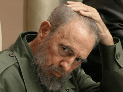 Cuban President Fidel Castro touches his head while attending the VII International Meeting about Globalization in Havana in 2005.