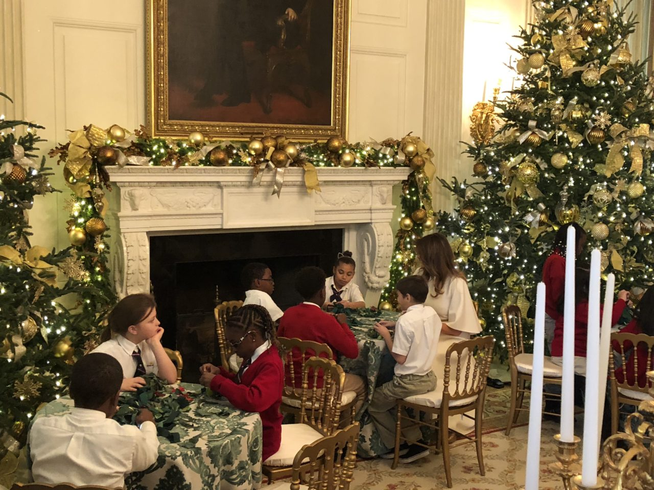 first lady melania trump visits with children making christmas wreaths in the white house state dining room