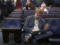 WASHINGTON, DC - FEBRUARY 24: New York Times reporter Glenn Thrush works in the Brady Briefing Room after being excluded from a press gaggle by White House Press Secretary Sean Spicer, on February 24, 2017 in Washington, DC. The New York Times, Los Angeles Times, CNN and Politico were also …