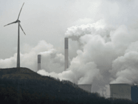 FILE - In this file photo dated Monday, Dec. 1, 2014, a wind turbine overlooks the coal-fired power station in Gelsenkirchen, Germany. A U.N.'s environment report Tuesday Oct. 31, 2017 says countries and industries need to do more to meet targets to trim emissions of greenhouse gases that experts say …