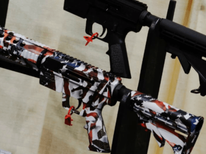 A gun with an American flag decoration at a trade show by the National Rifle Association, which has consistently opposed efforts at tighter gun control