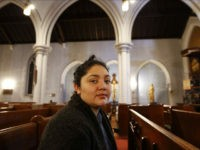 In this Oct. 26, 2017 photo, Amanda Morales, 33, poses for a photograph in the sanctuary of the Holyrood Episcopal Church, northern Manhattan. Morales has been living in two small rooms of the gothic church at the northern edge of Manhattan since August, shortly after immigration authorities ordered her deported to her homeland of Guatemala. (AP Photo/Kathy Willens)