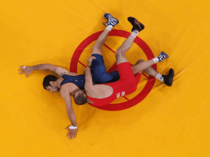 Omid Haji Noroozi of Islamic Republic of Iran (L) competes with Revaz Lashkhi of Georgia in their Men's Greco-Roman 60 kg Gold Medal bout on Day 10 of the London 2012 Olympic Games at ExCeL on August 6, 2012 in London, England. (Photo by Ian Walton/Getty Images)