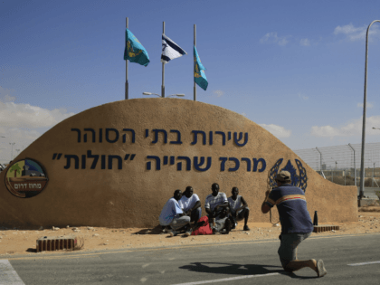 African migrants pose for a photograph in front of the Holot detention center in the Negev Desert, southern Israel. Tuesday, Sept. 23, 2014. A high Israeli court has condemned the government's policy of detaining illegal African migrants captured in the Negev Desert, ordering that the Holot detention facility be closed …