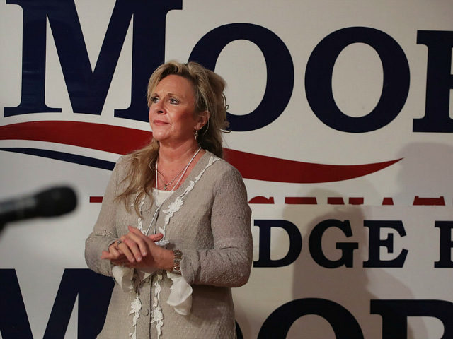 FAIRHOPE, AL - SEPTEMBER 25: Kayla Moore, the wife of Republican candidate for the U.S. Senate in Alabama Roy Moore, listens as her husband speaks at a campaign rally on September 25, 2017 in Fairhope, Alabama. Moore is running in a primary runoff election against incumbent Luther Strange for the …